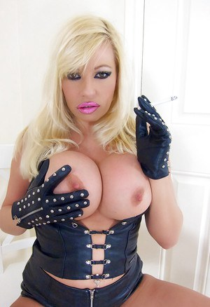 Big tits milf Michelle Thorne is masturbating while wearing boots