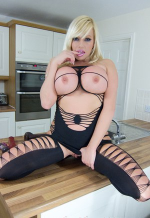 Big tits pornstar Michelle Thorne posing in black stockings and high heels
