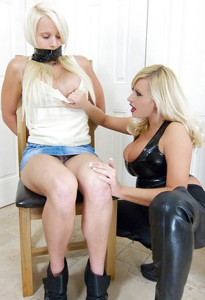 Lesbian milf Michelle Thorne is teasing a tied blonde teen babe