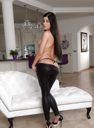 European babe with a fantastic ass April Blue undressing in high heels
