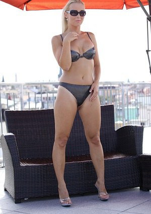 European milf Anesa Chance is showing off in a black bikini suit