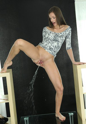 Silvia Luca is pissing on camera, while has no panties on her