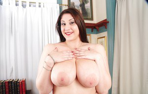 Fat mature slut Angel is showing her natural big tits and ass