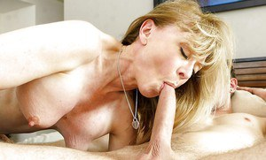 Mature mom Nina Hartley is having an amazing sex with a younger dude