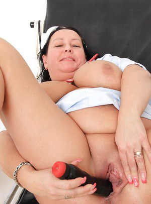 Robi Slava cures herself by masturbating pussy with a black dildo