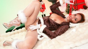 Adorable babe Roni wants to reach sexual peak in a hot Christmas dress