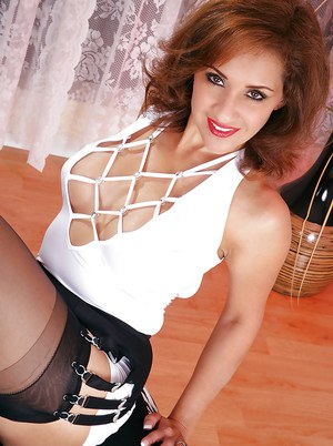 Cuddly mature in sexy black stockings Roni posing in her house