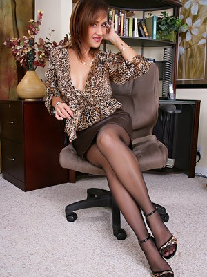The best mature woman Roni is showing her boobs in the office