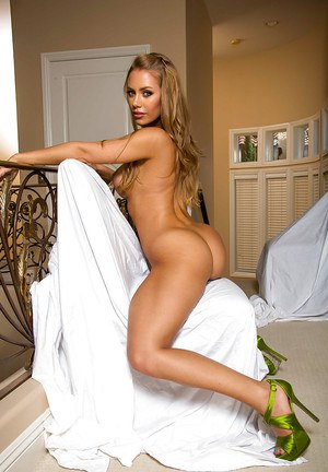 Cute and sexy Nicole Aniston gets naked to reveal her nice booty