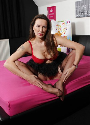 Jane is waiting for her husband and stripping in attractive lingerie