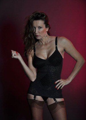 Jane prefers posing in black stockings and playing with hair