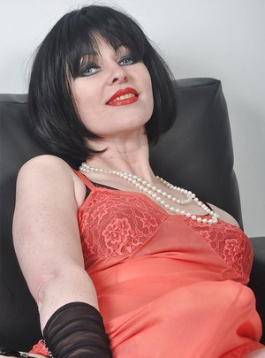 Cuddly milf Helga loves working with a huge strapon on camera