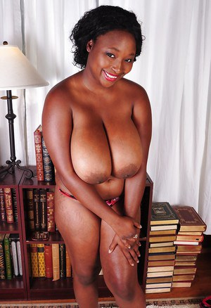 Ebony mature with big tits Marie is showing off in a lingerie