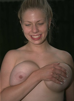 Busty Christy likes to show off her curves and her big tits outdoors