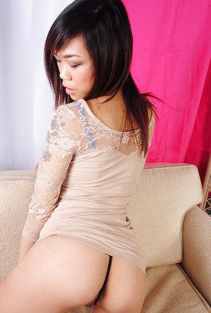 Asian brunette Minnie is revealing her shaved ass on camera