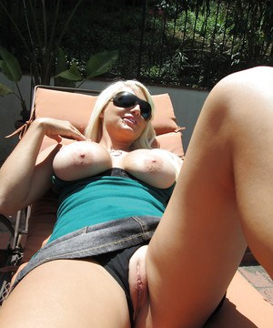 Outdoor posing scene from a big tits milf beauty Jacky Joy at the pool
