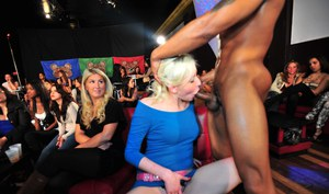 Clothed ladies are having fun with a strippers huge dagger and his ass