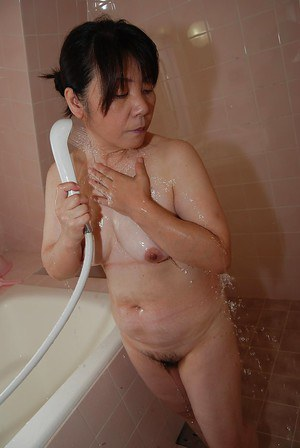 Sayuri Nozawa is teasing her hairy pussy while taking a hot shower