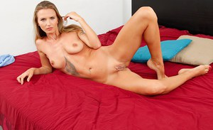 Milf blondie with tiny tits and sexy ass Alina Long is posing in lingerie