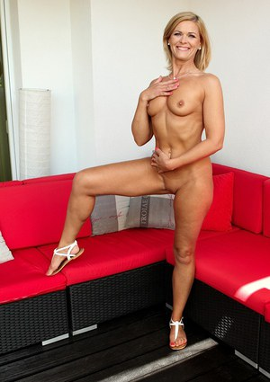 Tiny tits milf Carrie is undressing her sexy skirt and showing her pussy