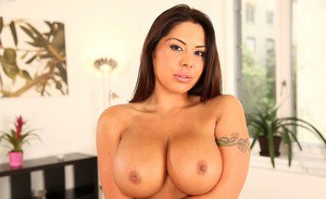 Tattooed babe with big tits Candy Coxx is undressing her sexy skirt