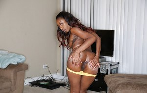 Tiny tits ebony teen is revealing her ass in a sexy yellow underwear