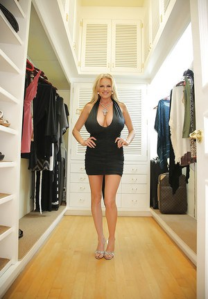 Clothed beauty Kelly Madison is demonstrating her natural big tits