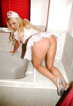 Blonde pornstar Dannii Harwood is showing her ass in a sexy uniform