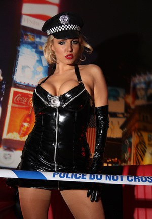 Big tits babe Dannii Harwood is showing off in a police uniform