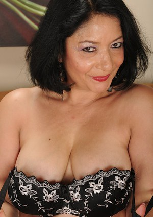 Close up undressing session featuring big tits mature Isis Fajardo