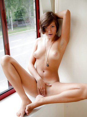 Masturbating babe with short hair Meddie is caught on camera