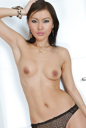 Clothed Asian Agnes reveals her amateur tiny tits and asshole