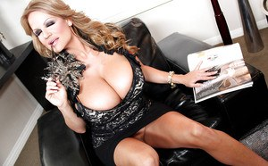 Masturbating mature Kelly Madison reveals her big tits in close up