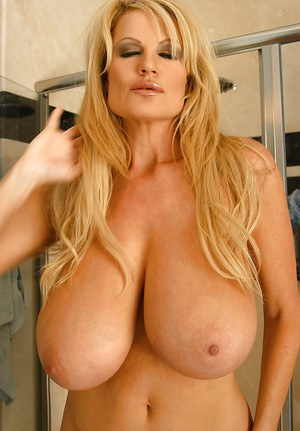 Stunning babe with big boobies Kelly Madison undresses in bathroom