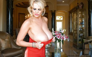 Close up posing scene features amateur mature with big tits Kelly Madison