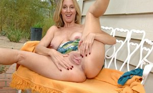Mature chick with big tits Jenna Covelli poses outdoor in her panties