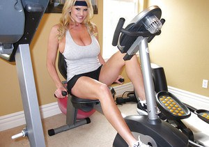 Kelly Madison shows her big natural tits while she does some sports