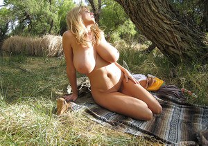 Outdoor posing scene of an amateur milf babe in a lingerie Kelly Madison