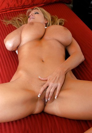 Kelly Madison takes part in an masturbating and posing scene