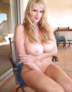 Masturbating and undressing action from an big tits milf Kelly Madison