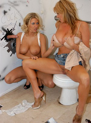 Riley Evans demonstrates her big tits while having a groupsex