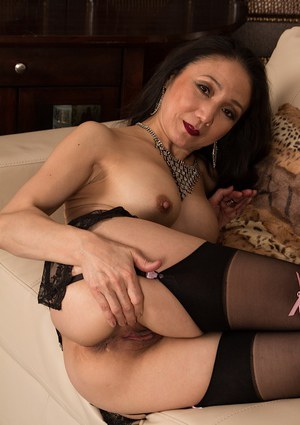 Asian milf Aya May has her ass shown in sexy high heels and stockings