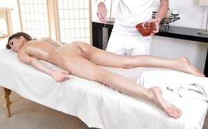 Oiled pornstar Riley Reid receives an awesome massage from her man