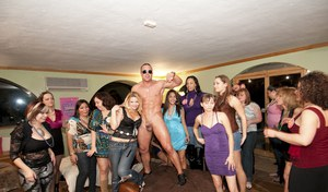 Clothed party with busty chicks doing handjobs and blowjobs