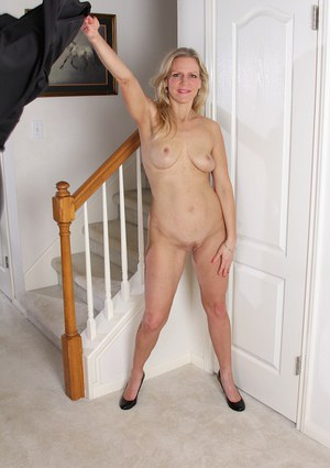 Blonde babe Tabitha Green reveals her milf big tits in close up