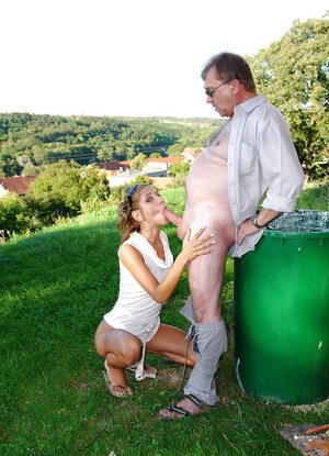 Outdoor cumshot scene with a marvelous girl doing blowjob to her man