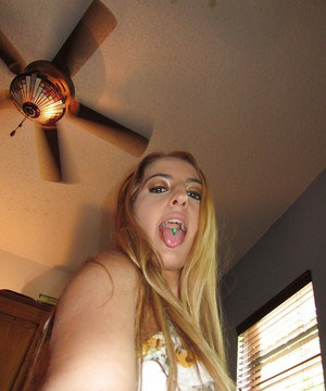 Clothed Latina blondie Tarra Marie shows off her big natural tits