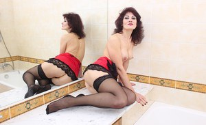 Brunette mature chick Melisa teases her pussy in her bathroom
