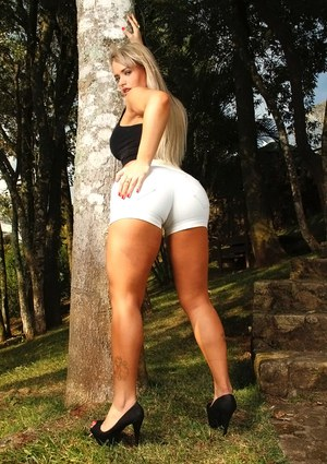Angel Lima reveals her big tits and tight ass outdoor in high heels