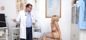 Mature beauty Sava reveals her pussy while going through a check at her doctor